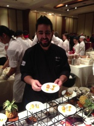Chef Thiago Silva serving Sticky Coconut Cake with Mango sauce