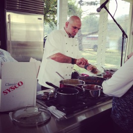 Chef Michael Psilakis serving the crowd.
