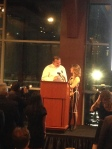 Chef Michael White accepting award from C-CAP President Susan Robbins